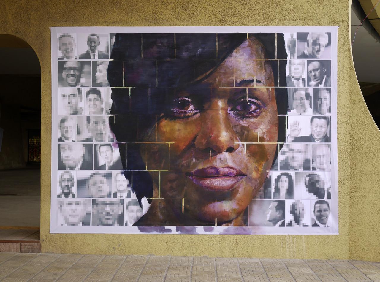 Où aller? Going where? Young woman. Acrylic paint on print 250 x 350cm. For Yango Biennale 2014. Congo Kinshasa